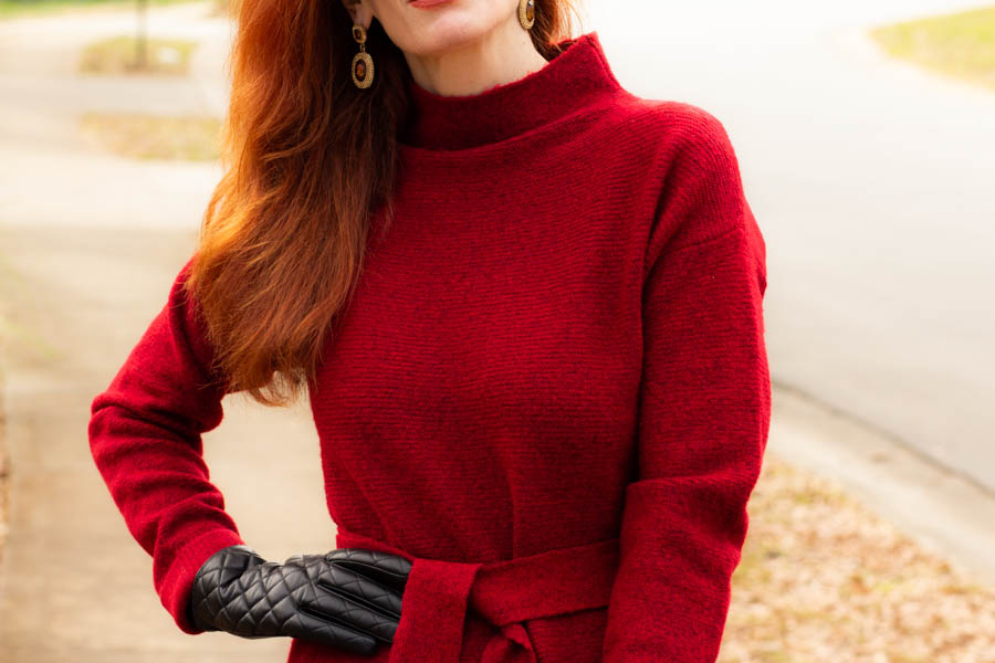 Women's red sweater dress and quilted leather gloves