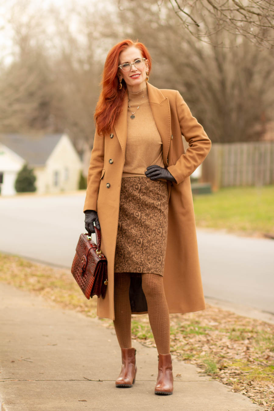 women's camel coat and neutral outfit