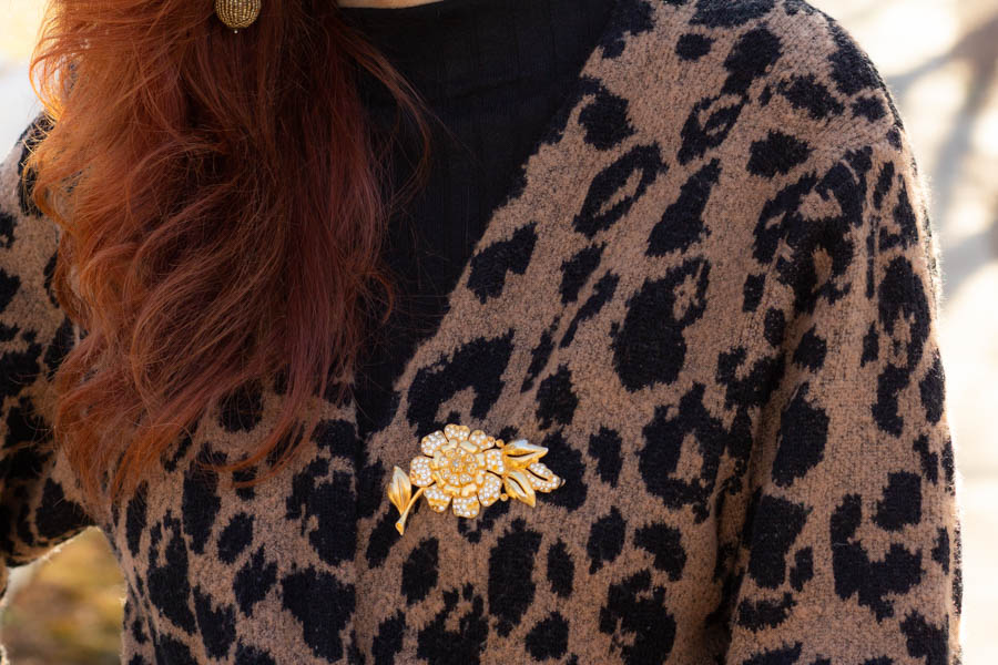Leopard cardigan over black dress
