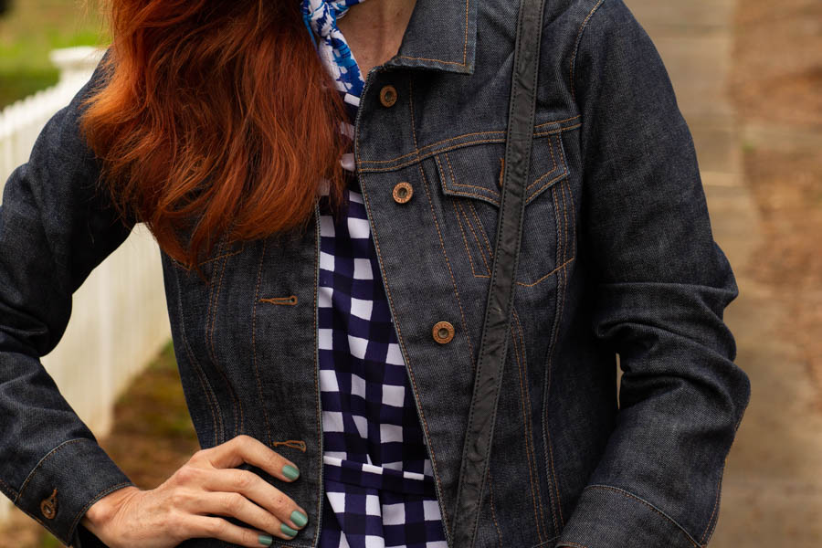 Denim jacket with gingham print dress