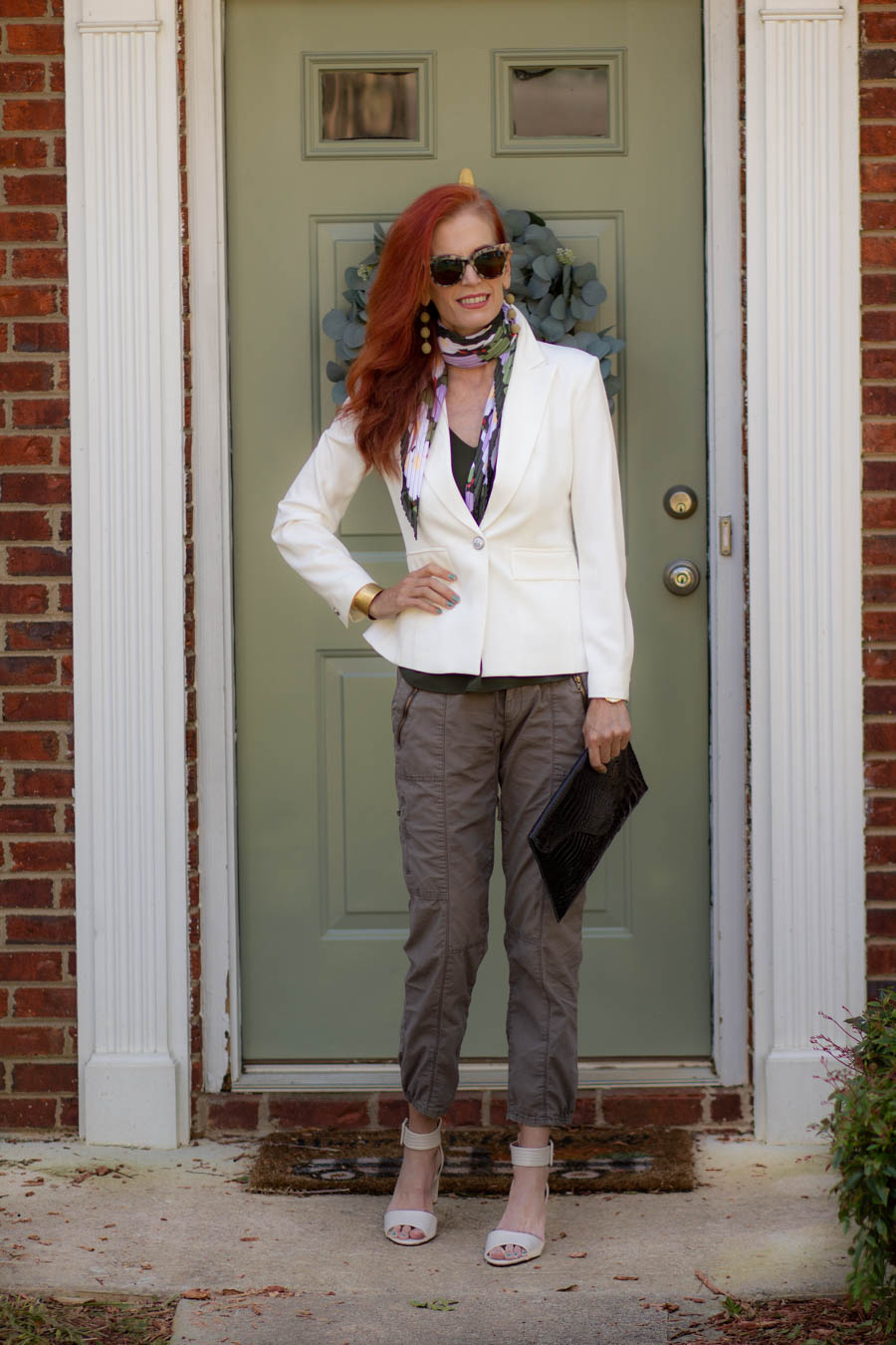 White blazer and olive cargo pants
