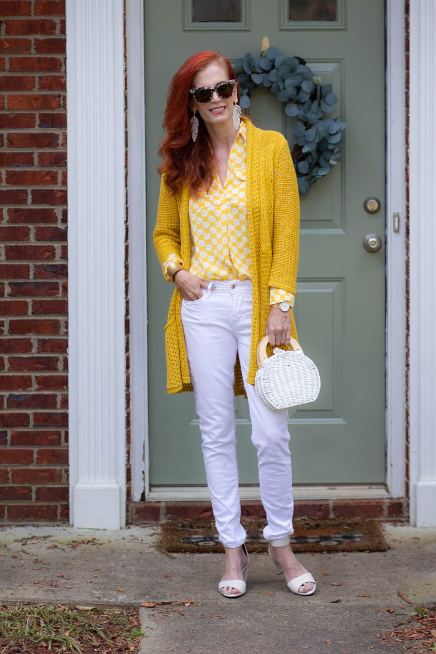 yellow and white blouse with white jeans
