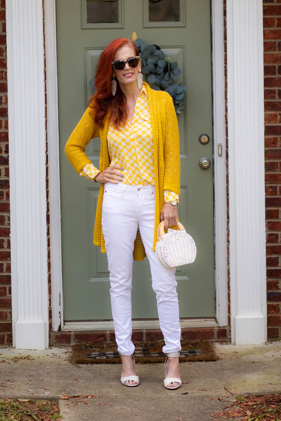 White and yellow blouse and white jeans