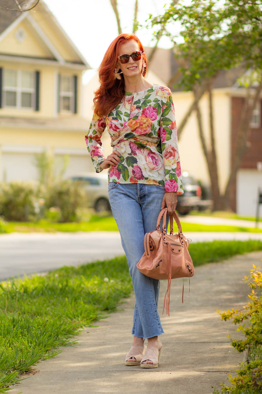 Bold floral blouse with light denim