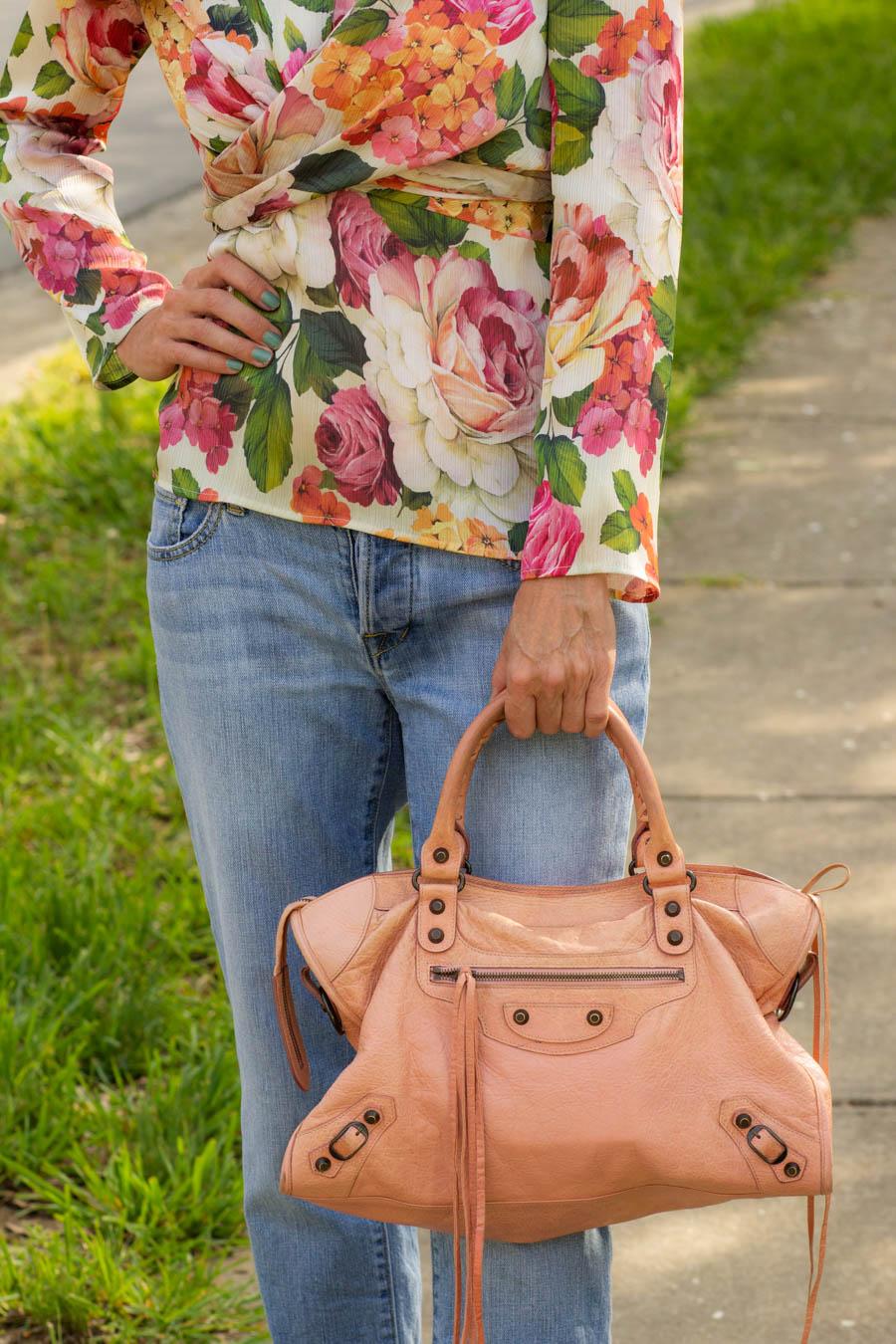 Bold floral blouse with Balenciaga bag