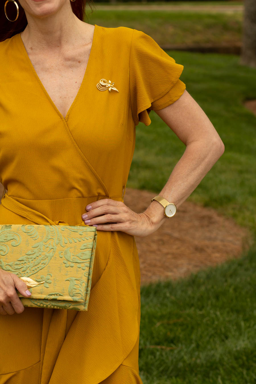 Mustard yellow dress with jacquard and gold clutch