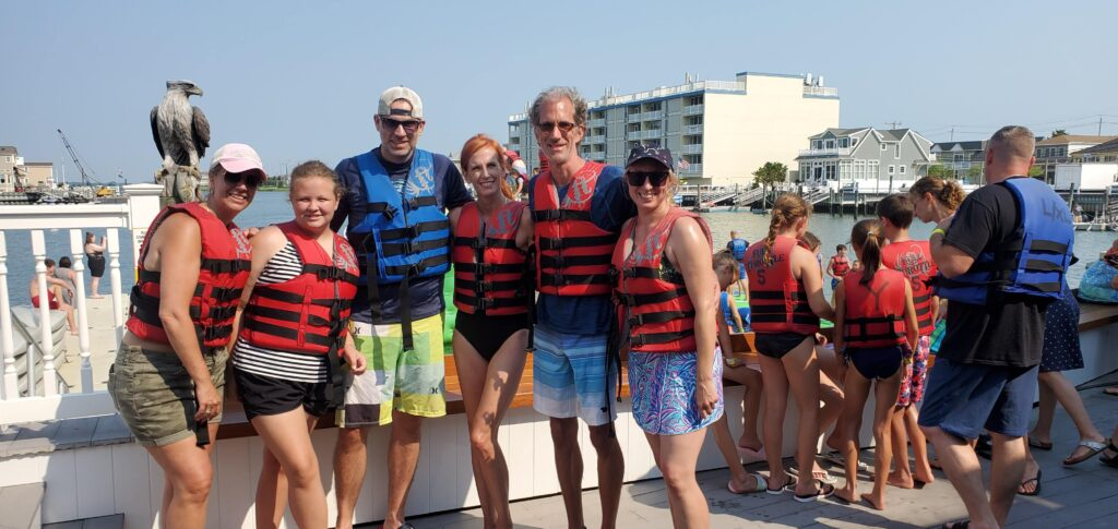 family in swimsuits and lifejackets