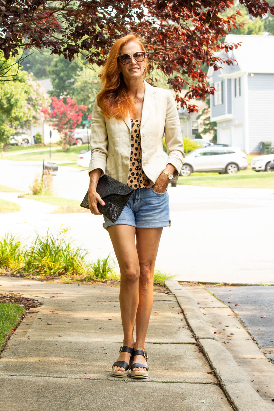 women's casual summer outfit with denim shorts and linen blazer