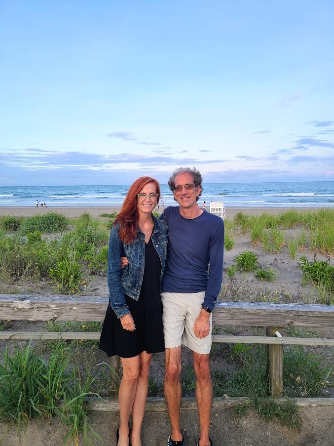 husband and wide on beach