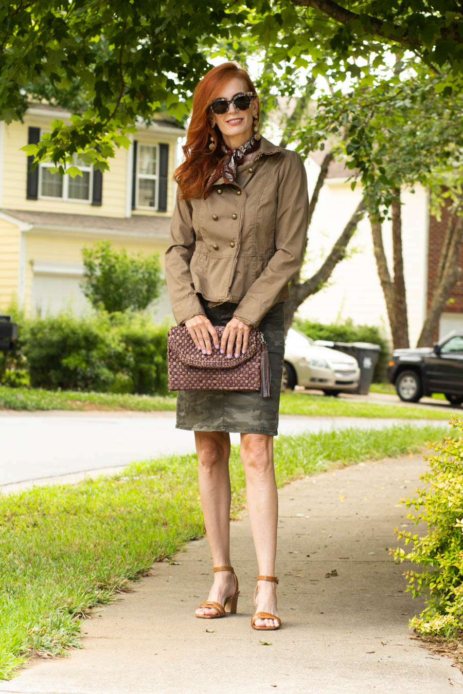Camo skirt and military jacket with brown sandals