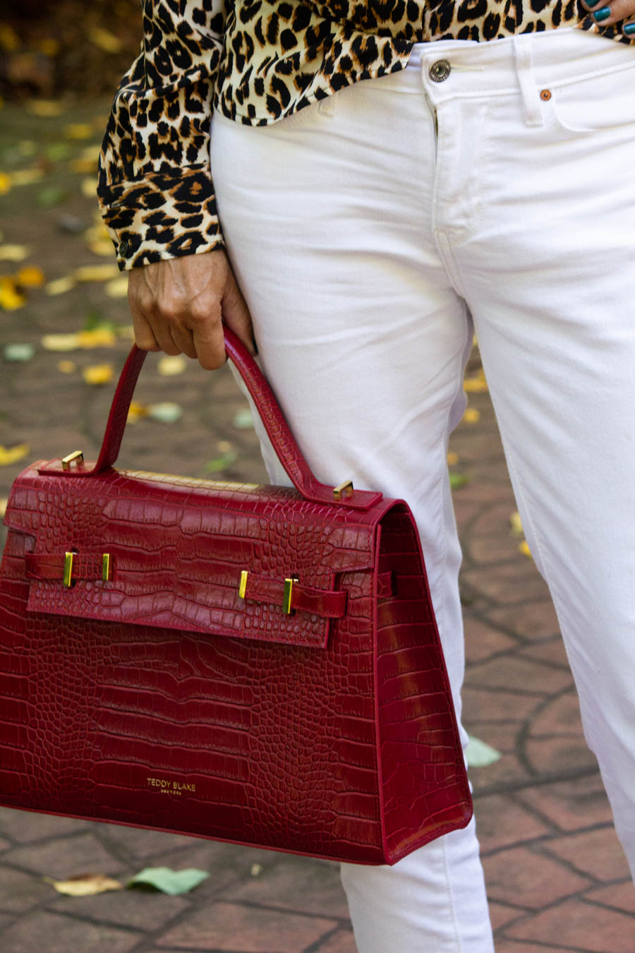 red structured bag, white denim and leopard blouse