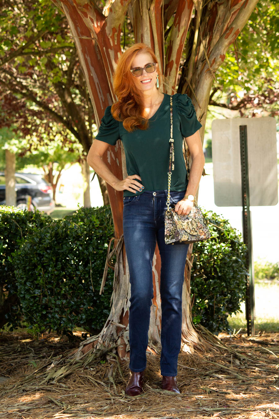 Pine green puff sleeved top and AG dark denim jeans