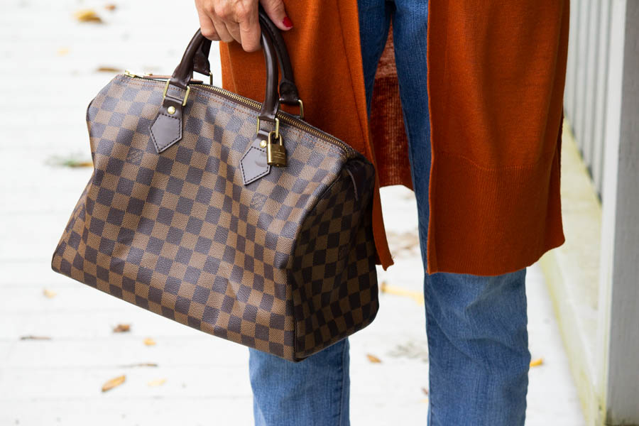Louis Vuitton speedy with cardigan and jeans