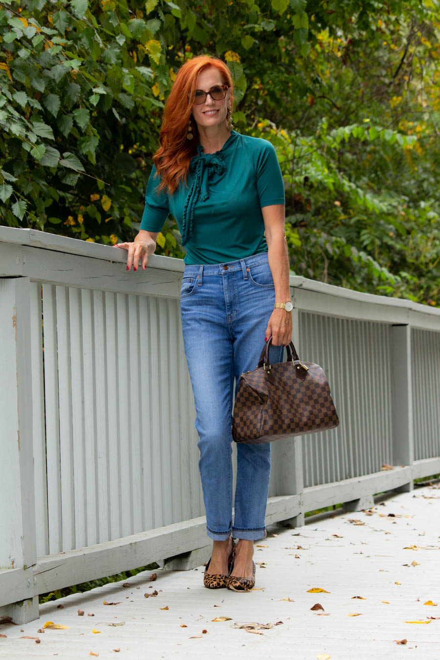 Teal blouse with straight leg jeans and LV bag
