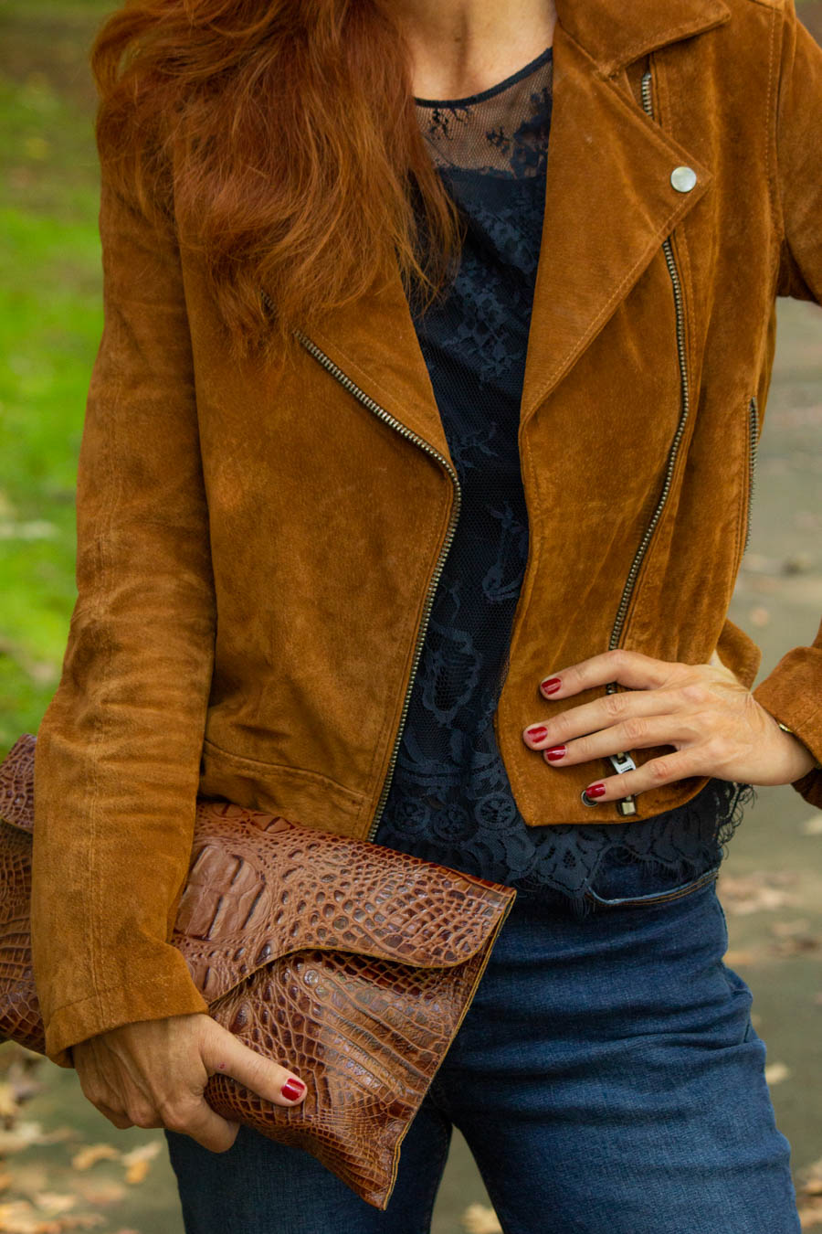 Navy lace top with cognac suede jacket and leather brown clutch