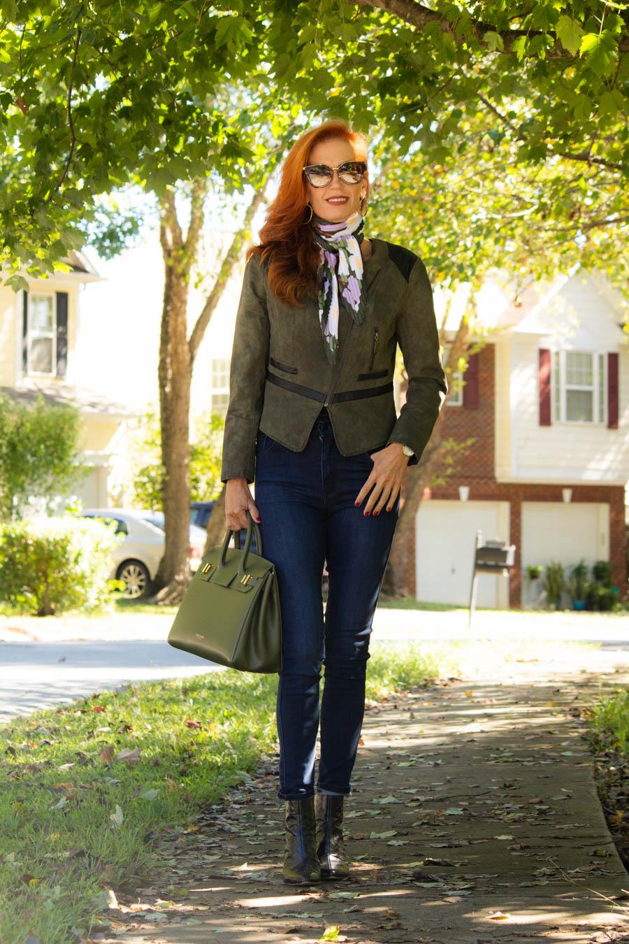 Olive moto jacket, jeans and Luxury Teddy Blake olive bag